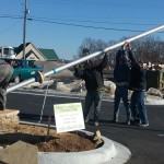 Raising the commercial flagpole in front of the building